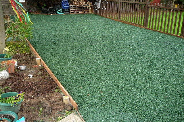 Timber edging retains the rubber chippings