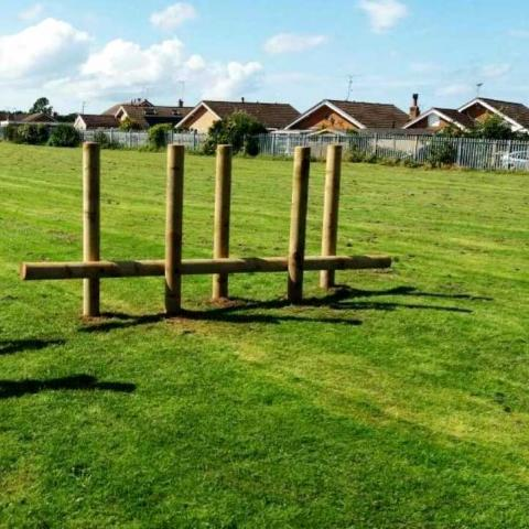 Inclined Log Twister for trim trails in playgrounds and schools