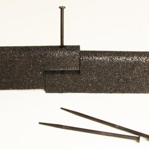 Rubber border edging is secured with plastic pins (pins are 250mm long)