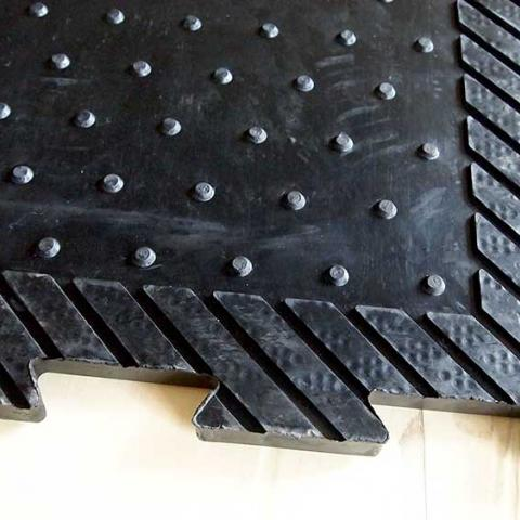 Rubber stable mat for equestrian use
